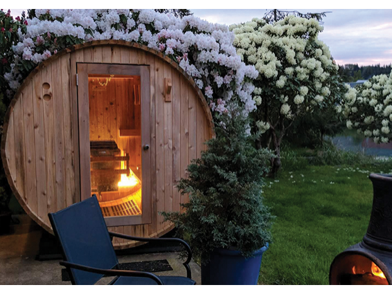 sauna-barrel-outdoors-with-campfire
