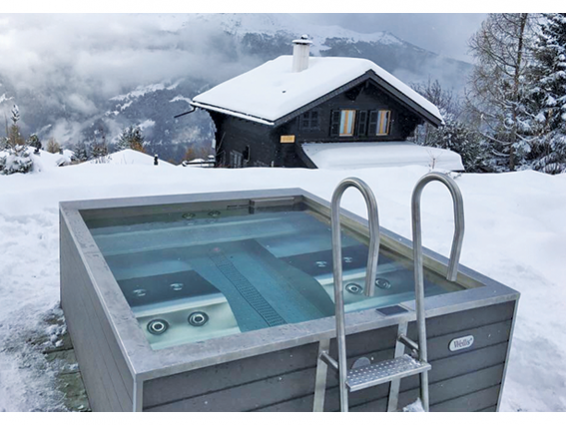 metal-spa-hot-tub-wellis-outdoors-on-snowy-mountaintop